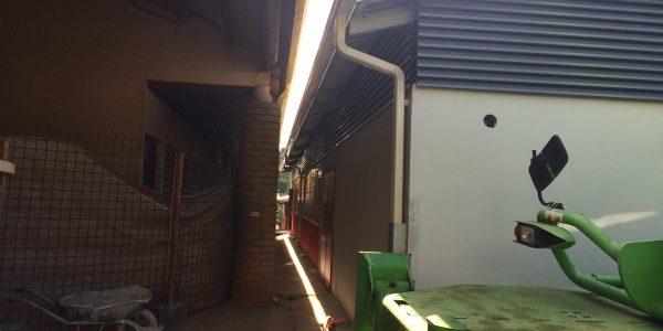 Pose de gouttiere sur le College M'Tsamgamouji